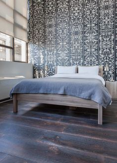 "The wallpaper in the guest bedroom is by Studio Job.  ""The pattern is based on little animal skeletons, but if you zoom out it looks very classical."""