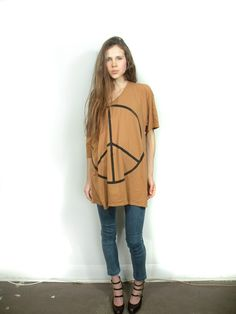 Peace shirt, I love...don't like the jeans or shoes at all.