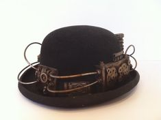 this is a steampunk bowler hat. with technological detail made from resin, plastic and wire  the hat is a woolen bowler hat size 58cm or 7 1/8