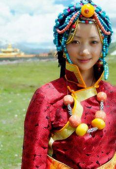 Tibetan girl wearing Tibetan jewelry - Love the full head of beads