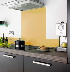 Mustard colour kitchen glass splashback