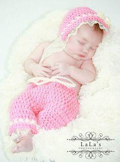 Newborn girls matching crochet pants and bonnet.