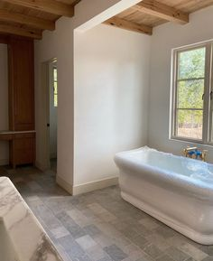 It's a plastic fantastic tub wonderland. This actually might be the only way I would take a tub. one lined in plastic that I could remove… Townsend Homes, Port Townsend, Grey Marble Bathroom, Master Bathroom, Bathtub Walls, Wood Garage Doors, Fireclay Tile, White Oak Floors, Colored Ceiling