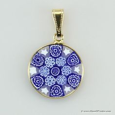 I first saw these millefiori pendants in Spain. They are like tiny stained glass windows when you hold them up to the light!