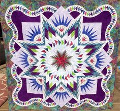 Glacier Star, Quiltworx.com, Made by CI Patsy Carpenter and quilted by Dyna Hall at Dyna Hall Creations with Quiltworx digital quilt design.