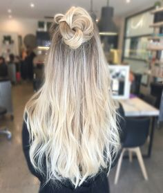 Blonde balayage, long hair, top knot, cool girl hair ✌️  Lived in hair colour Blonde bronde brunette golden tones Balayage face framing blonde  Textured curls