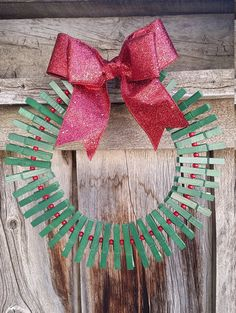 Darling Clothespin Christmas Card Holder Wreath. Measures inside to inside 6-8 inches, and outside to outside 12-14 inches. Can hold up to 20