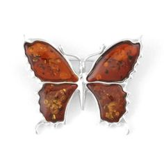 """Amber Butterfly Pin Item No. AM01707A01 $41.29 This butterfly pin has cognac Amber wings outlined with .925 sterling silver, and a Silver body. The amber features unique natural inclusions that catch the light and add depth to the clear stone."""