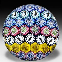 Mike Hunter 2014 patterned millefiori dragonfly and dolphin silhouettes glass paperweight.  by  Twists Glass Studio