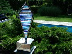 Mirrored stainless #steel. stained #glass #sculpture by #sculptor Jane Bohane titled: 'Pucci (Kite Shaped Blue + White Glass Garden statue)'. #JaneBohane