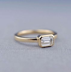 This minimalist solitaire engagement ring from Lily Emme Jewelry is so dainty and lovely!
