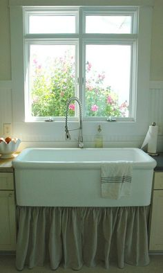 """We snatched up 4 ft. old surgeon's sink for $100 on Craigslist. It was taken from a local hospital. It had a very awesome crackle finish glaze, but there was so much discoloration that we couldn't keep it as it was. We had it refinished for $300. So, for $400, we got a truly unique piece for our kitchen! (Have you seen the prices of farmhouse sinks? This was a good buy!)"""""""