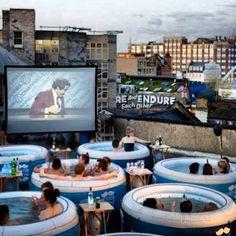 Rooftop jacuzzi cinema in London.