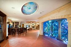 Entertainment Room with Aquarium Wall - mediterranean - basement - new york - Electronics Design Group, Inc.