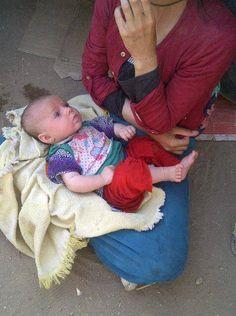 Baby Salwa, stuck 6 days on Mount #Sinjar, back smiling. Luckily 2 little 2 understand tragedy