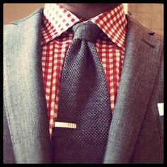 Checkered shirt with solid tie. Good look