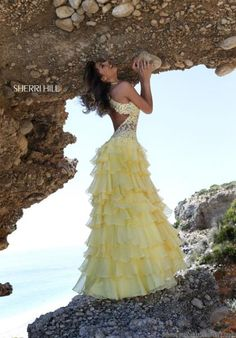 Don't like the color, but the dress is beautiful... pink or aqua would be lovely!  Sherri Hill Dress 11052 at Prom Dress Shop