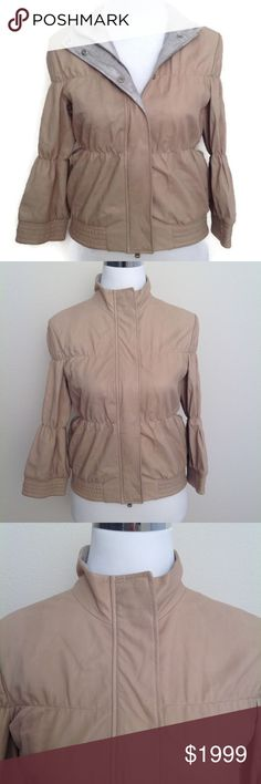 """BRUNELLO CUCINELLI Leather Jacket 42 Beige NWT This is a STUNNING NWT €3000 Brunello Cucinelli beige gathered sporty butter soft kid leather jacket with no lining size 42 or U.S 6 measurements are shoulder seam to seam 15 3/4"""" arm pit to pit doubled 35"""" waist doubled 30"""" sleeve from shoulder seam to cuff 17 3/4"""" length 20 3/4"""" this gorgeous eyes piece has 2 ways zipper and buttons has two external pockets in okay condition this is a very sensitive and delicate leather there are some stains…"""