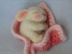 needle felt bunny in a crocheted blanket by Barby Anderson