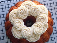 Pretty Vanilla Bean Cream Cheese Frosting Roses on a Hummingbird Bundt Cake