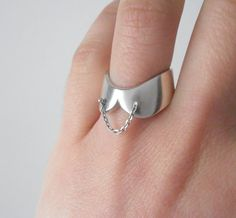 Sterling collar ring.