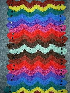 Free knitting pattern for Garter Snake Rug - Beth Khan's rug uses a simple lace pattern to create the snake bodies and cast-ons and bind-offs for the heads and tails