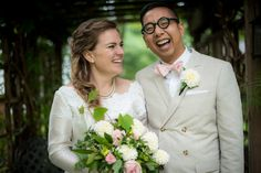 bride with her bridesman laughing | bride wearing grandma's antique dress | bridesman in khaki suit with light pink tie and white dahlia boutonniere and white pocket square | Planned by Sixpence Events & Planning | Photo by Elliot Malcolm