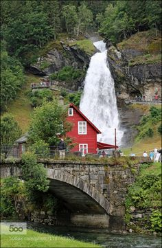 Another roadside attraction in Norway by bodie  red house stone arch stone bridge waterfall bodie