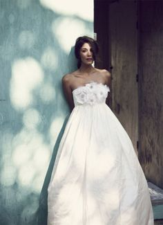 love the simple- love the pure white tone of the dress and the shadow shot of this photograph