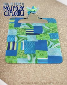 Mod Podge Clipboard - Learn how to turn a drab clipboard into a colorful -- and useful -- work of art! (http://aboutfamilycrafts.com/mod-podge-clipboard/)