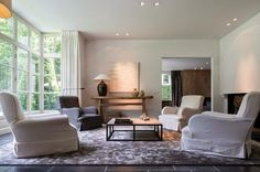 Elegant Belgian living rooms. If you like to decorate your living room in the Belgian style, you should combine rustic elements with a modern aesthetic to create a simple, not boring, yet cozy and comfortable room.  Choose for a neutral and soft color palette, no strong colors. Notice that nowadays