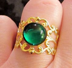 Gold Victorian Style Adjustable Filigree Ring with Vintage Green Glass Cabochon $10.00
