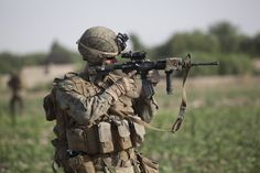 U.S. Navy Corpsman, Kyle Rudolph with Headquarters Platoon, Alpha Company, 1st Battalion, 7th Marine Regiment, Regimental Combat Team 6 scans for suspicious activity through his Rifle Combat Optic while supporting a patrol in Sangin, Helmand province, Afghanistan on July 11, 2012. The patrol was part of Operation Gospand-Sia, which was led by the Afghan National Army. Photo by Lance Cpl. Sean Searfus