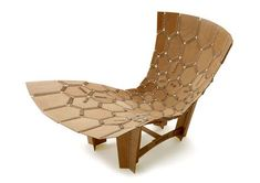 Knitting is rarely associated with anything but the most kitsch (or at least outdated) styles of furniture, used almost exclusively to cover pieces rather than hold them together. In this patchwork wooden lounge chair, however, the design strategy is entirely different: shaped wood strips are bound with tightly-wrapped rope material, their very structure dependent upon the fabric that fills the gaps.
