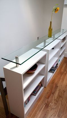 We've been wanting to replace the banister that separates the stairs and living room into a built-in bookcase for years. This isn't exactly what I was picturing but I do like it. Looking for more ideas too...