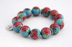Bracelet - light blue - #handpainted on #wood  This #bracelet contains of 13 hand painted wooden beads of 15 mm. All metal items are nickel free. The hand painted wooden beads have light blue surface and are painted with #pink flowers. The length is 15 cm and the weight is 15 grams.