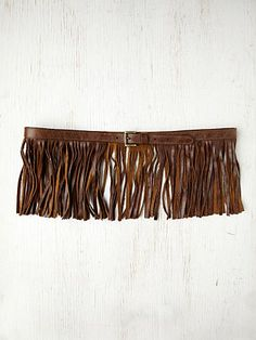 "Falcon Fringe Belt  Style: 24317554  Leather buckle belt with fringe all around. Adjustable.     *By Streets Ahead   *100% Italian Leather   *Made in USA   *Measurements for Small: 38"" total length, 7"" width (including fringe)   $198"