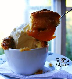 Caramelized peach cobbler with whipped cream. Found this recipe through someone I follow. I changed the recipe slightly by caramelizing the peaches in a little brown sugar, honey, nutmeg and cinnamon before putting them into ramekins and topping.