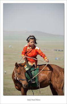 A young rider, Ulaan Baatar, Mongolia. (V)