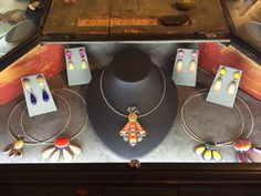 Handmade jewelry by artist Holly Stein. Displayed in Outnumbered Gallery in Downtown Littleton. Necklaces and earrings