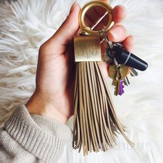 She'll never misplace her keys again with this oversized, leather tassel key ring. The keychain comes with an engravable cube for her to show off her new name. It's available in five colors for her to match with her favorite purse or wallet, too. | Monogrammed Wedding Gifts For The New Bride