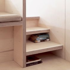 Stairs leading up to the platform bed double as storage for books. Tagged: Storage Room, Shelves Storage Type, and Under Stairs Storage Type. Photo 5 of 11 in This Small Slate Cabin Rental is the Ultimate Outdoor Oasis