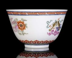 A rare imperial famille roseBuddhist emblems bowl 'Bajixiang', China, underglaze blue Qianlong six-character seal mark and period.Photo Nagel