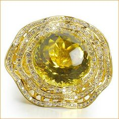 Lemon Topaz ring with diamonds set in 18k yellow gold by Farah Khan