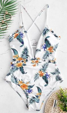 As time goes by, you'll keep loving this pretty one-piece swimsuit with all over beautiful flowers in an eased fit. It boasts a sultry plunging front, adorable frilled trims along the front waist and slim shoulder straps that are crossed at back for making a suitable fit. Padded cups are inserted to offer comfortable support. Just get ready to hit the beach in our new one-piece style!