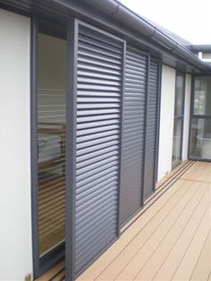 Sliding shutters are a great option for protecting exposed west facing windows