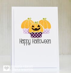 handmade Halloween card from Stamping & Sharing ... clean and simple ... cupcakes with orange icing and pumpikin stems ... one with a Jack-o-Lantern face ... luv it! ... Clearly Besotted .....