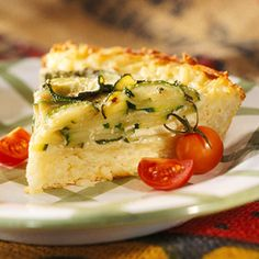 This savory pie has a cheese and  hash brown potato crust. It's a delicious base for a vegetable-custard filling.