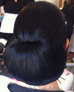 Sleek elegant chignon bridal style. Hair styled by Chanae Hiller at Ahead of Style Hair Artistry.