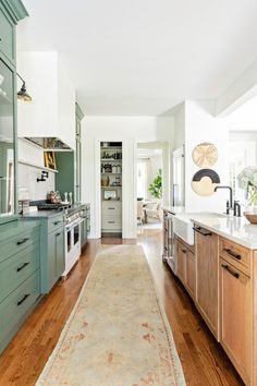 Galley style kitchen with shaker cabinets and wood floor #kitchen #kitchendecor
